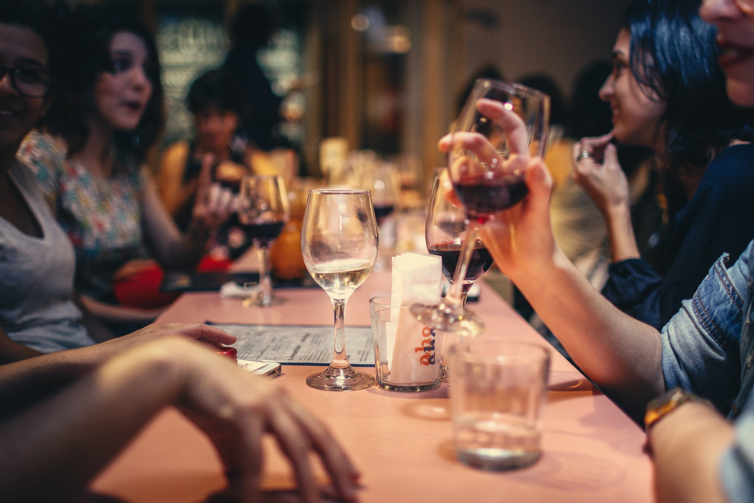 people-drinking-liquor-and-talking-on-dining-table-close-up-696218